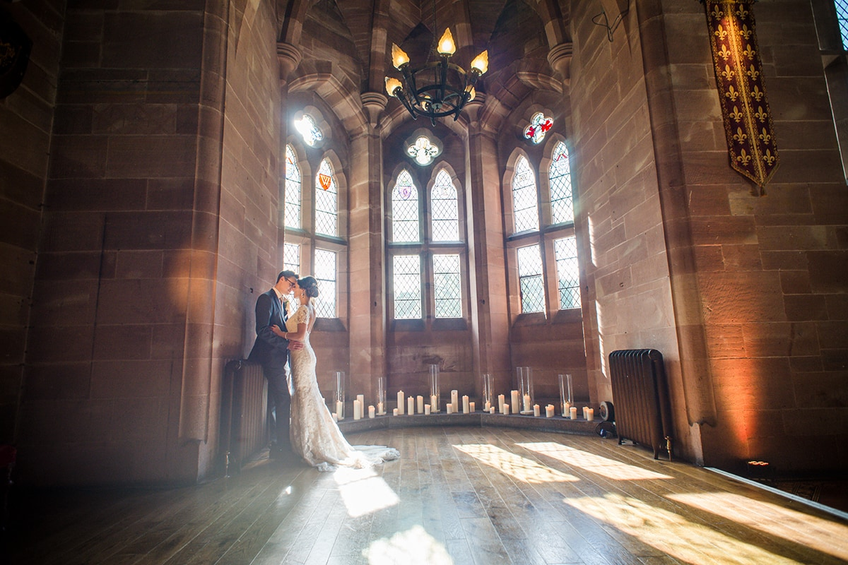Pecforton Castle Wedding The Great Hall Bride and Groom Light spilling Catherine Bradley Photography